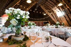 antique barn wedding..love the centre pieces!
