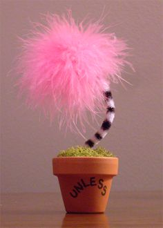 """Mini potted Truffula Trees, inspired from the Dr. Seuss children's book, """"The Lorax"""".  Each Truffula is individually handmade using real moss and a ceramic clay pot bearing the Lorax' final warning: """"UNLESS"""". Trees are approx. 5-6 inches tall, and are currently only available in a classic pink...."""