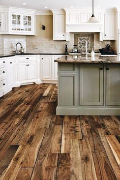 Natural hard wood floors - white cabinets - accented sea foam island ◇◇◇