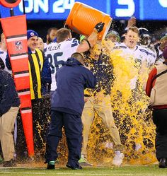 Super Bowl XLVIII - The game was so out of hand in the fourth quarter that the Seahawks had time to douse coach Pete Carroll with Gatorade.  Read More: http://sportsillustrated.cnn.com/nfl/photos/1402/si-best-photos-from-super-bowl-xlviii//28/#ixzz2sJj7JhY8