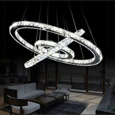 Modern Crystal 3 Rings Circle Ceiling Lamp Chandelier LED Pendant Lighting The cool white light color can ship same day or within after payment with FedEx from the US to a US location only. If this lamp runs out of stock in . Ring Chandelier, Antique Chandelier, Modern Chandelier, Chandelier Lighting, Luxury Chandelier, Crystal Pendant Lighting, Led Pendant Lights, Crystal Chandeliers, Artistic Installation