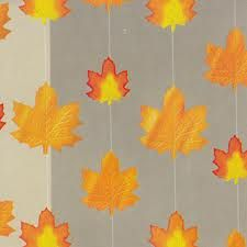 Awesome fall party decor! String fall leaves on embroidery thread for a hanging curtain
