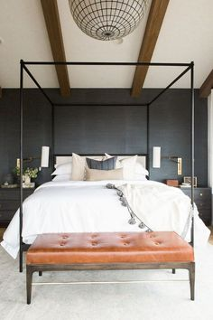 This bedroom combines modern metal and rustic wood for a relaxed feeling.