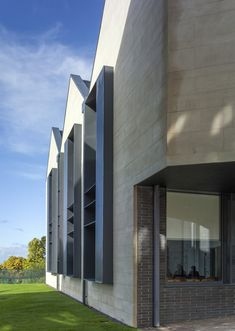 School building by Mitchell Taylor Workshop contrasts pale stone with grey brick