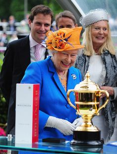 The Queen Elizabeth smiles as she presents the Gold Cup during Day Three of Royal Ascot...