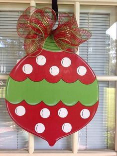 Front door decor, front door decorations, Christmas wreath, Christmas door hangers, Christmas Ornament Door Hanger Personalized Christmas Ball for your door. Hand Cut and Painted by Me. Measures 21 by including the bow. This Christmas Ball can be Grinch Christmas Decorations, Whoville Christmas, Christmas Yard, Christmas Design, Christmas Projects, Christmas Wreaths, Christmas Ornaments, Christmas Door Hangers, Christmas Centerpieces
