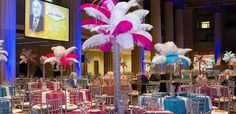 Feathered centerpiece and tablescape for corporate event by Socially Artistic Events.