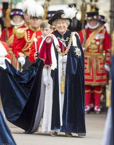 Making an entrance: The Queen leads the Order of the Garter into St. George's Chapel in Windsor for the traditional service