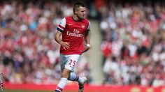Arsenal's promising young defender Carl Jenkinson has committed his future to England after talks with manager Roy Hodgson.