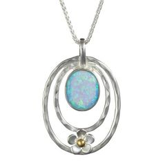 Hammered silver pendant set with blue/green Opalite and flower detail with brass centre.Comes on chain and fastened with a Fishlock clasp. Pendant Set, Flower Pendant, Pendant Necklace, Hammered Silver, Brass, Sterling Silver, Discount Designer, Blue Green, Branding Design