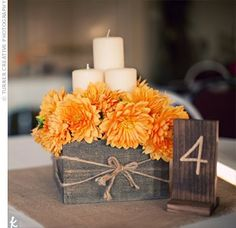 centerpiece-box with flowers and chunky candles