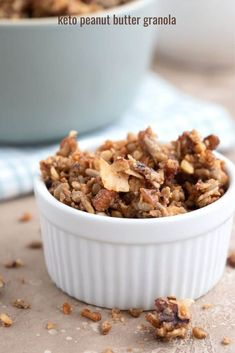 Low carb granola in a white ramekin on a brown table.