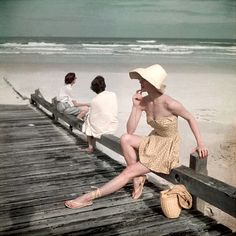 A model wearing beachwear beside the sea, as published in the May issue of Vogue magazine, United States, 1949, photograph by Serge Balkin.