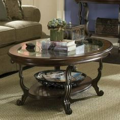 The Riverside Ambrosia Oval Coffee Table is poetry in motion. Coffee Table Styling, Decorating Coffee Tables, Coffee Table Design, Oval Glass Coffee Table, Riverside Furniture, Formal Living Rooms, Living Room Furniture, Table Decorations, Home Decor