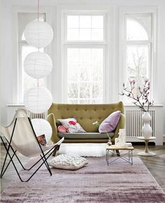 Light and airy sitting room // crepe lanterns // windows