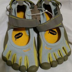 Vibram Fivefingers Barefoot Five Finger Toe Shoes Good Condition.  Signs of wear on right heel.  Blue, gray, yellow and green. Vibram Shoes Athletic Shoes