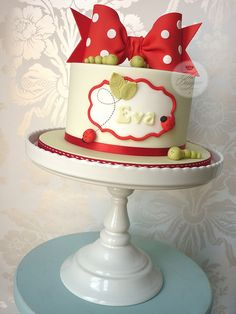 Ladybugs and caterpillars!  love the simplicity of this cake, the stand up bow, the sharp lines and the medallion on the front. ♥