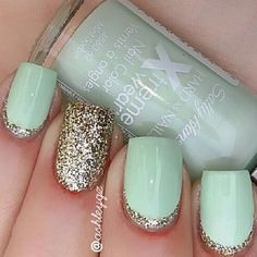 Classic looking light green matte polish and silver glitter nail art design on the nail cuticles.