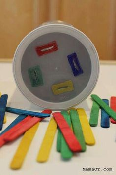 popsicle sticks and en empty coffee can to work on preschool fine motor. Colorful popsicle sticks and en empty coffee can to work on preschool fine motor.,Colorful popsicle sticks and en empty coffee can to work on preschool fine motor. Preschool Fine Motor Skills, Motor Skills Activities, Toddler Learning Activities, Montessori Activities, Infant Activities, Kids Learning, Communication Activities, Preschool Age, Sorting Activities