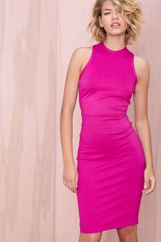 Get ready to kill it in this hot pink bodycon midi dress featuring crossed straps at back, zip/hook closures, and ribbing at neckline. Wear it with minimal heels and an over-the-shoulder blazer--perfect for work and that hot date you have afterwards.