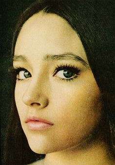 Olivia Hussey. Vintage. Doll eye makeup with thick eyebrows.