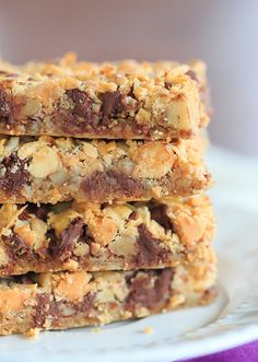 Seven Layer Bars, aka Magic Bars - Seven glorious layers of graham crackers, nuts, chocolate chips, white chocolate chips, butterscotch chips, coconut and sweetened condensed milk! | http://www.browneyedbaker.com/seven-layer-bars/