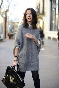 winter outfit idea - oversized gray fizzy sweater layered over a button up shirt and worn with black skinny jeans