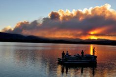 #HighParkFire smoke plume spreads over west Larimer County behind fishermen at Terry Lake north of #FortCollins Colorado.