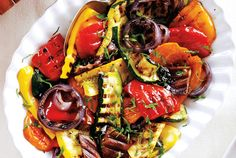 GRILLED BALSAMIC VEGETABLES: This rustic dish is perfect for entertaining because you can serve it at room temperature or straight from the grill. It also makes a great filling for a vegetarian sandwich. Just spread chevre or herbed cream cheese over a crusty roll or piece of baguette and sandwich the grilled vegetables.