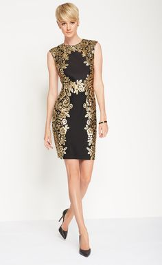 A beautiful gold tone foil print lends this little black dress by Madison Leigh elegant style.
