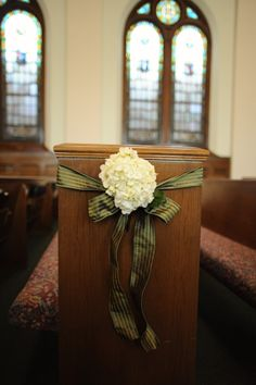 lovely  and simple pew decor. Navy stripe ribbon small green flower