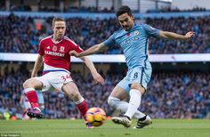 City's No 8 Ilkay Gundogan (right) whips in a cross with his left foot, while under pressure from Boro's No 34 Forshaw