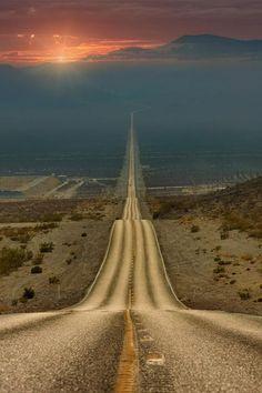 Desert highway at sunset