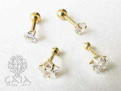 Barbell para cartilagem ou lóbulo, aço cirúrgico banhado a ouro com aplicação de zircônia em formato de coração ou estrela. http://www.gaiabodyart.com.br/cartilagem-lobulo