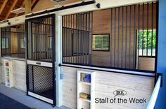 These stalls are sharp!!  They feature diamond crosshatch and horizontal wooden rails in contrasting colors.  The full height hinged feed door also acts as a yoke, allowing horses to hang their heads out.  The blanket bar & built-in shelves are ideal for daily equine care.