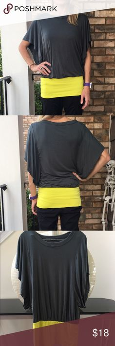 Anthropologie banded waist tunic top In very good used condition. Teal with batwing sleeves and a neon yellow fitted waistband. Brand is Ella Moss. Very soft and stretchy! Length is 31 inches long and bust measures 18 inches across laying flat. Thanks for looking. Anthropologie Tops Tunics