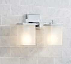 Bathroom Sconces & Lighting For Bathrooms | Pottery Barn; square to go with more angular aspect of cabinet, and then a round mirror to soften?