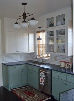 Warehouse Shades, Schoolhouse Lights Feature in Kitchen Remodel   Blog   BarnLightElectric.com  Subway tile backsplash, the green cabinets with the slate ish counter tops and vintage light fixtures just like I want...