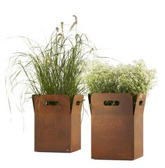 Box planter, designed by Michael Koenig for Flora. Box is available in a wide range of sizes and finishes, ranging from powder coated steel through to oxidised Corten steel as shown here. Box is also optionally available with interior or exterior planting inserts, which are watertight and insulated.
