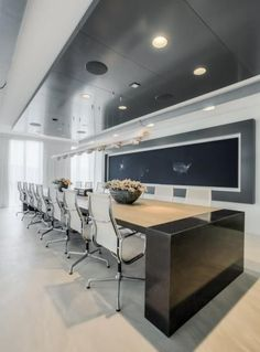 Sleek modern conference room. Definitely wouldn't mind a few meetings here.