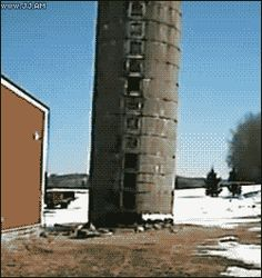 "FARM DEMOLITION DANGERS - OLD GRAIN SILO ""WALKS"" ACROSS YARD AS IT FALLS DOWN - COOL ACTION GIF"