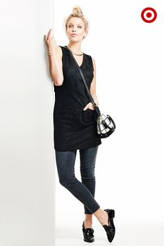 Something simple to try that could totally change the way you dress up your jeans: throw a little black dress over your dark skinnies or jeggings. Add your it-bag (plaid, please), and you're ready to go out.