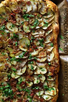 Morrocan Spiced Scalloped Potato Pizza.  No cheese. Instead topped with fresh mint and arugula. Vegan.