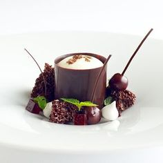 Black Forest cake as a sophisticated gluten-free dessert. Gluten free flour blend, dark Valrhona chocolate and cherries. It's served with a light, minty Chantilly cream and wafers of aerated chocolate. Best Gluten Free Desserts, Fancy Desserts, Köstliche Desserts, Plated Desserts, Delicious Desserts, Dessert Recipes, Beste Desserts, Individual Desserts, Creative Desserts