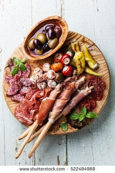 Antipasto Platter Cold meat plate with grissini bread sticks on blue wooden background Antipasti Platter, Meat Platter, Food Platters, Cheese Platters, Come Reza Ama, Charcuterie And Cheese Board, Cold Cuts, Best Meat, Meat And Cheese