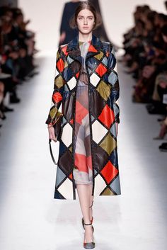 Valentino Fall 2014–After last season's Opera inspired outing, Valentino designers Maria Grazia Chiuri and Pier Paolo Piccioli looked to 60s Italian pop art for the house's fall-winter 2014 collection. Opening the new season with jackets and separates featuring multi-colored dots, it was clear that autumn was about interjecting bold prints into a wardrobe of princess perfect dresses and gowns. Diamond cuts, brocade butterflies and roses serve as the other ...