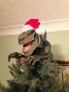 Frightening: The snarling face of Godzilla featured at the top of this tree. Christmas Tree Design, Funny Christmas Tree Toppers, Christmas Tree Quotes, Creative Christmas Trees, Christmas Tree Star, Christmas Tree With Gifts, Christmas Tree Themes, Xmas Tree, Christmas Humor