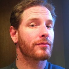 Corey Taylor! Oh, how I miss your long hair! :( But you're still hot! :)