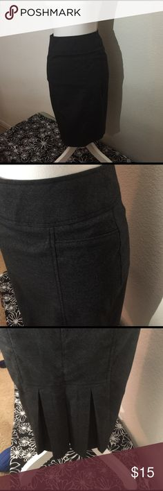 """Gray pencil skirt Smooth front gray pencil skirt with kick pleats in the back. Made of polyester, rayon and spandex. Measures 21"""" in length Forever 21 Skirts Pencil"""