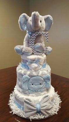 Baby boy elephant diaper cake. Baby shower gift/ centerpiece. Check out my Facebook page Simply Showers for more pics and more diaper cakes. https://m.facebook.com/adorablegifts #babystuffproducts